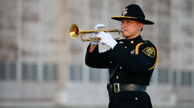 Honor Guard member playing trumpet