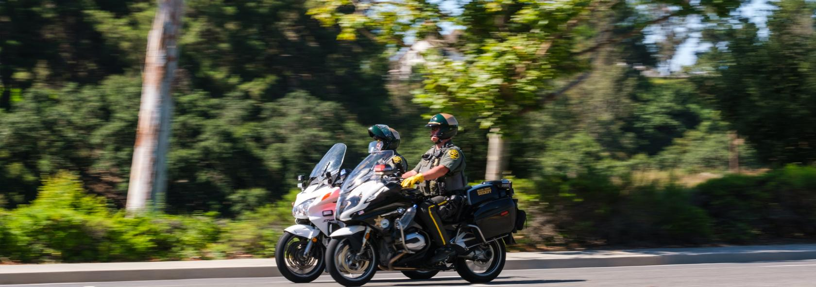 Two police officers driving motorcycles